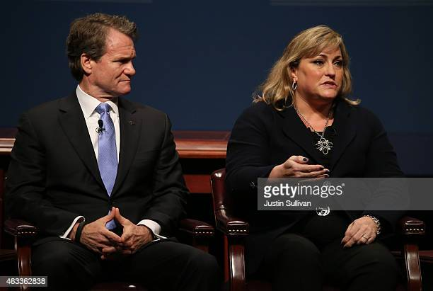 Bank of America chairman and CEO Brian Moynihan looks on as Intel president Renee James speaks during the White House Summit on Cybersecurity and...