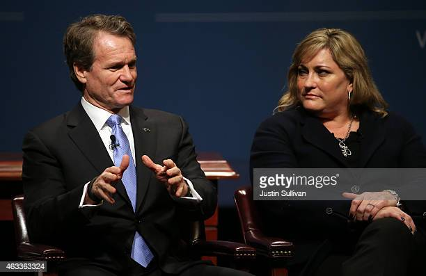Bank of America chairman and CEO Brian Moynihan speaks as Intel president Renee James looks on during the White House Summit on Cybersecurity and...