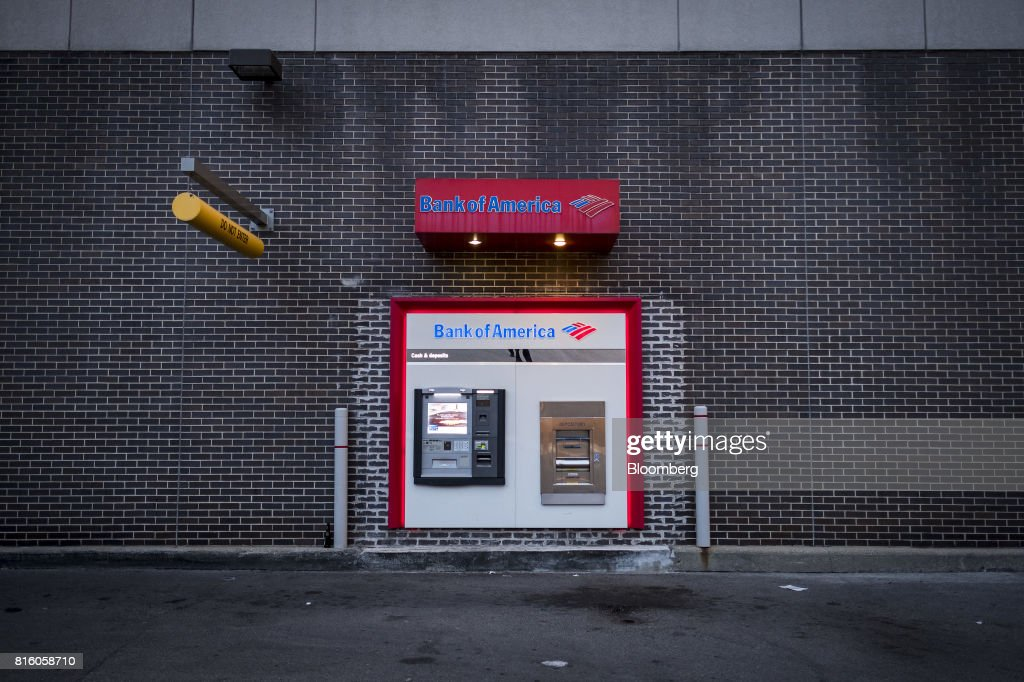 A Bank of America Corp. automatic teller machine (ATM) stands outside a branch in Chicago, Illinois, U.S., on Tuesday, July 11, 2017. Bank Of America Corp. is scheduled to release earnings figures on July 18. Photographer: Christopher Dilts/Bloomberg via Getty Images