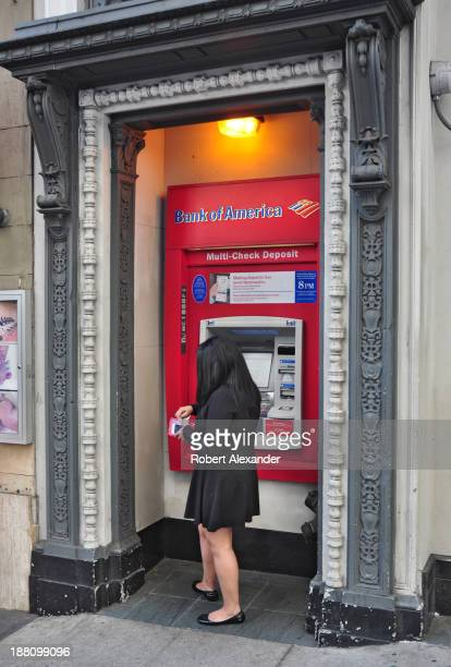 Bank of America customer prepares to make a withdrawal at an ATM machine in downtown San Francisco California