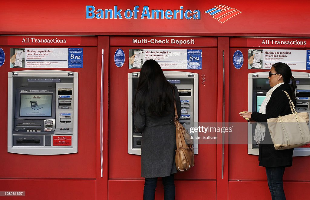Bank of America customers use an ATM on January 21, 2011 in San Francisco, California. Bank of America reported a fourth quarter loss of $1.2 billion, or 16 cents a share, bringing total losses for the year to $2.23 billion, or 37 cents a share.