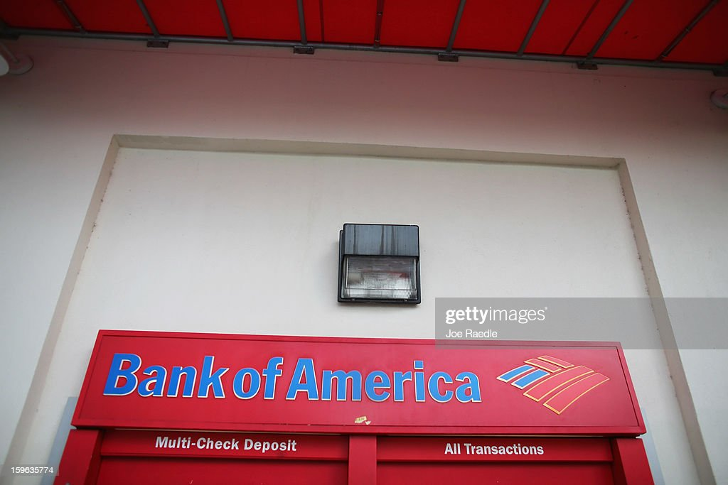 A Bank of America sign is seen on an ATM machine on January 17, 2013 in Miami, Florida. The bank reported a 63 percent drop in fourth-quarter profit after making payments to settle legal claims over its mortgage business.