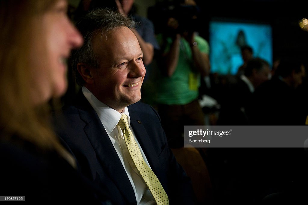 Bank of Canada Governor <a gi-track='captionPersonalityLinkClicked' href=/galleries/search?phrase=Stephen+Poloz&family=editorial&specificpeople=10846368 ng-click='$event.stopPropagation()'>Stephen Poloz</a> laughs with attendees while waiting to deliver his first speech at the Oakville Chamber of Commerce luncheon in Burlington, Ontario, Canada, on Wednesday, June 19, 2013. Poloz said the nation will need a rebound in business confidence to drive growth in coming years, a process that will require 'stability and patience.' Photographer: Galit Rodan/Bloomberg via Getty Images