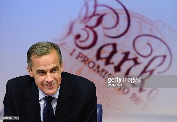 Bank of England Governor Mark Carney holds a press conference on the quarterly inflation report at his office on November 12 2014 in London England...