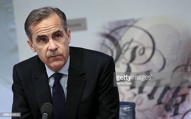Bank of England Governor Mark Carney listens to a reporter's question during a press conference about the Financial Stability Report at the Bank of...