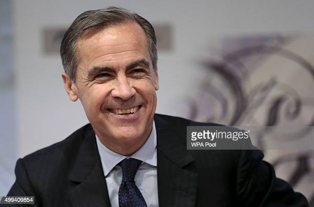 Bank of England Governor Mark Carney smiles during a press conference about the Financial Stability Report at the Bank of England on December 01 2015...