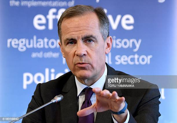 Bank of England Governor Mark Carney who is also chair of the Financial Stability Board gestures as he answers questions during a press conference in...
