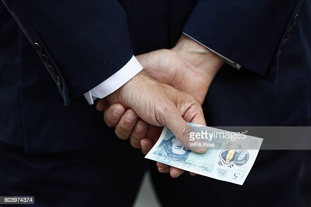 Bank of England governor Mark Carney with a new polymer five pound note at Whitecross Street Market on September 13 2016 in London United Kingdom The...