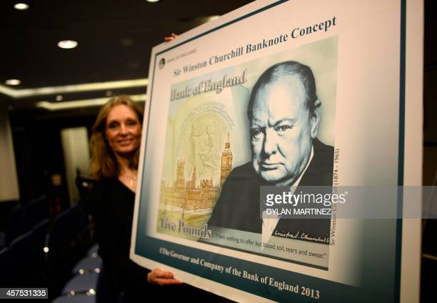Bank of England's Head of Notes Division Victoria Cleland shows off the concept design of the new polymer fivepound banknote after a news conference...