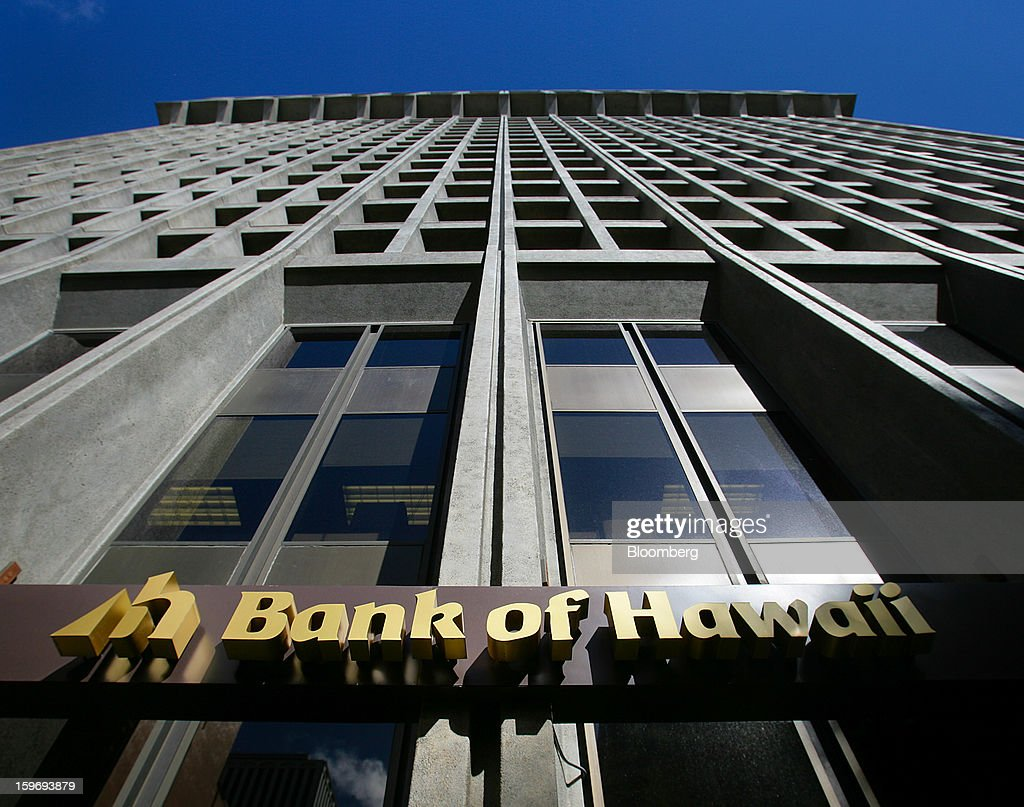Bank of Hawaii Corp. signage is displayed outside of a branch in Honolulu, Hawaii, U.S., on Wednesday, Jan. 9, 2013. Honolulu, the southernmost major U.S. city, is a major financial center of the islands of the Pacific Ocean. Photographer: Tim Rue/Bloomberg via Getty Images