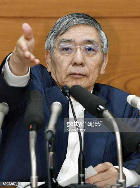 Bank of Japan Gov Haruhiko Kuroda gestures during a press conference at the BOJ's headquarters in Tokyo on Sept 21 after a twoday meeting of the...