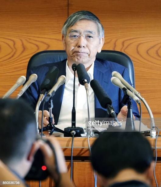 Bank of Japan Gov Haruhiko Kuroda listens to questions from a reporter during a press conference at the BOJ's headquarters in Tokyo on Sept 21 after...