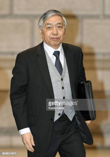 Bank of Japan Governor Haruhiko Kuroda arrives at the central bank's head office in Tokyo on March 16 for the final day of its twoday policy meeting...
