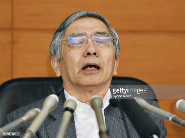 Bank of Japan Governor Haruhiko Kuroda attends a press conference after a policy meeting in Tokyo on June 16 2017 The central bank decided to...