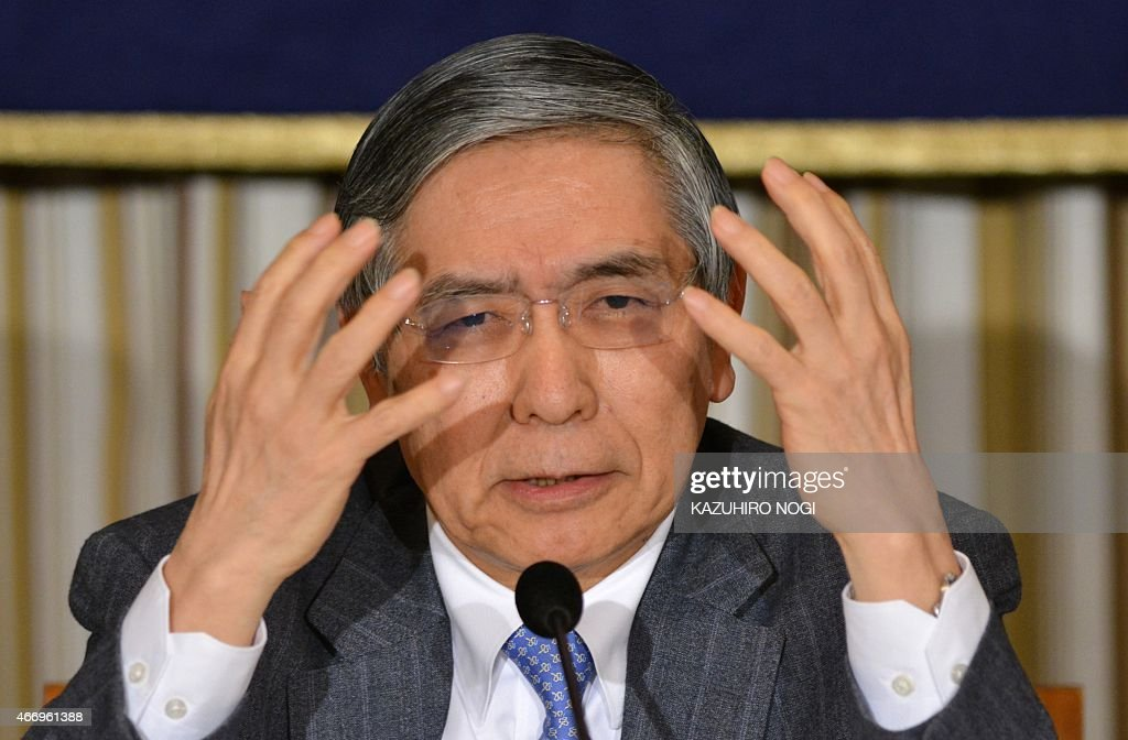 Bank of Japan governor Haruhiko Kuroda gestures as he answers questions during a press conference at the Foreign Correspondents' Club of Japan in Tokyo on March 20, 2015. Kuroda spoke to reporters nearly two years after he was sworn in as the central bank chief, with the bank's two-year time-frame for its two percent inflation target approaching.