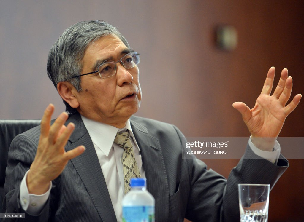 Bank of Japan (BOJ) Governor Haruhiko Kuroda gestures as he speaks before press during an interview at the bank headquarters in Tokyo on April 10, 2013. The market reaction to a deluge of easy money that began flooding Japan last week is 'within expectations', the central bank's new chief said on April 10. AFP PHOTO / Yoshikazu TSUNO