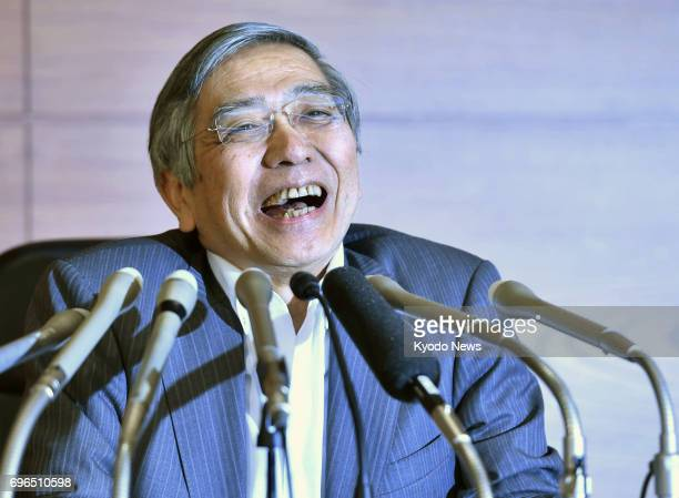 Bank of Japan Governor Haruhiko Kuroda holds a press conference at the BOJ's headquarters in Tokyo on June 16 following a decision by the central...