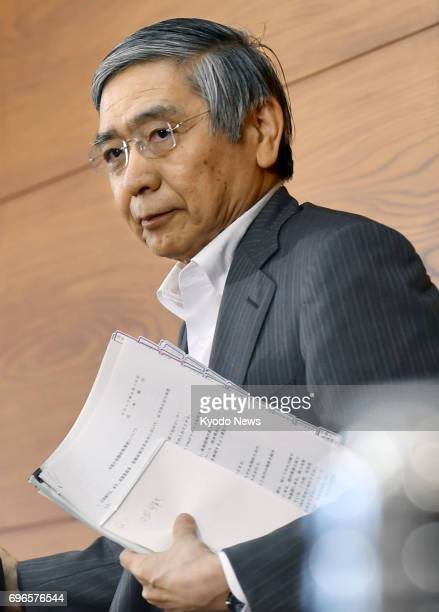 Bank of Japan Governor Haruhiko Kuroda leaves a press conference in Tokyo on June 16 2017 The central bank decided to maintain its monetary easing...