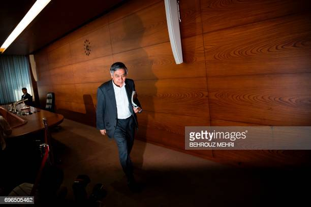 Bank of Japan governor Haruhiko Kuroda leaves after a press conference in Tokyo on June 16 2017 The Bank of Japan stood by its pledge to achieve...