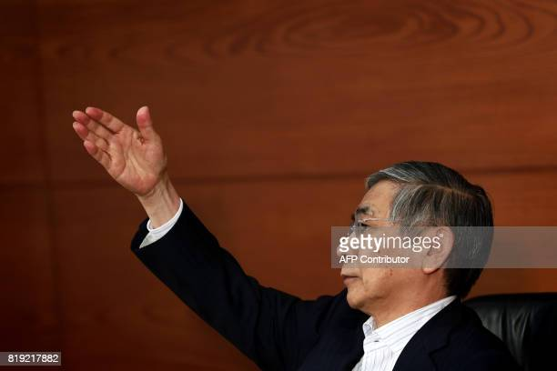 Bank of Japan governor Haruhiko Kuroda points at a journalist to ask a question during a press conference in Tokyo on July 20 2017 The Bank of Japan...