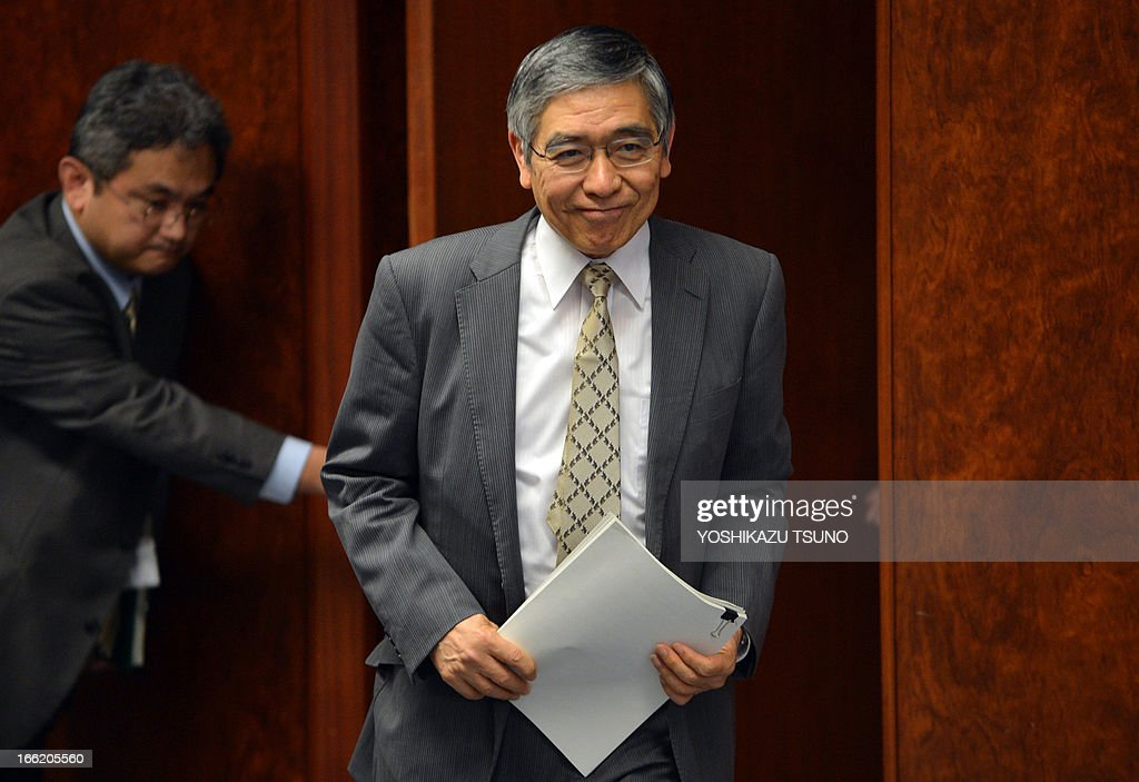 Bank of Japan (BOJ) Governor Haruhiko Kuroda smiles as he meets with press during an interview at the bank headquarters in Tokyo on April 10, 2013. The market reaction to a deluge of easy money that began flooding Japan last week is 'within expectations', the central bank's new chief said on April 10. AFP PHOTO / Yoshikazu TSUNO