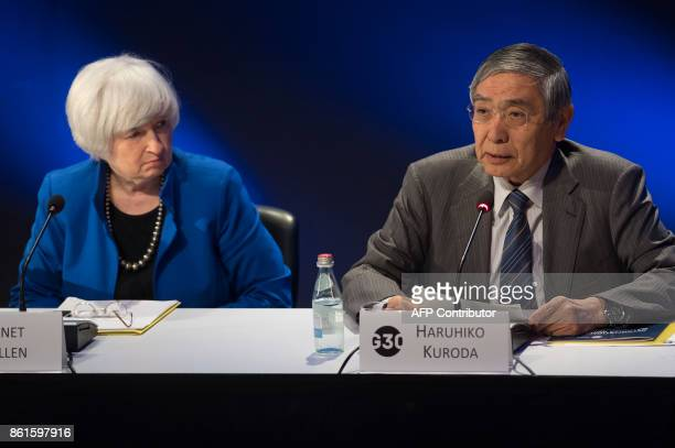 Bank of Japan Governor Haruhiko Kuroda speaks alongside Federal Reserve Chair Janet Yellen during the 32nd Annual Group of 30 International Banking...