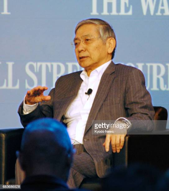 Bank of Japan Governor Haruhiko Kuroda speaks at a symposium hosted by The Wall Street Journal in Tokyo on May 16 2017 Kuroda said the central bank...