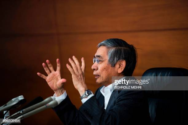 Bank of Japan governor Haruhiko Kuroda speaks during a press conference in Tokyo on June 16 2017 The Bank of Japan stood by its pledge to achieve...