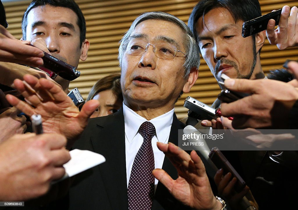 Bank of Japan Governor Haruhiko Kuroda (C) speaks to reporters after a meeting with Prime Minister Shinzo Abe at the prime minister's official residence in Tokyo on February 12, 2016. Japanese government officials on February 12 pledged to take 'appropriate measures' as the surging yen fuels speculation that the central bank will intervene in currency markets to arrest its ascent. JAPAN OUT AFP PHOTO / JIJI PRESS / AFP / JIJI PRESS / JIJI PRESS