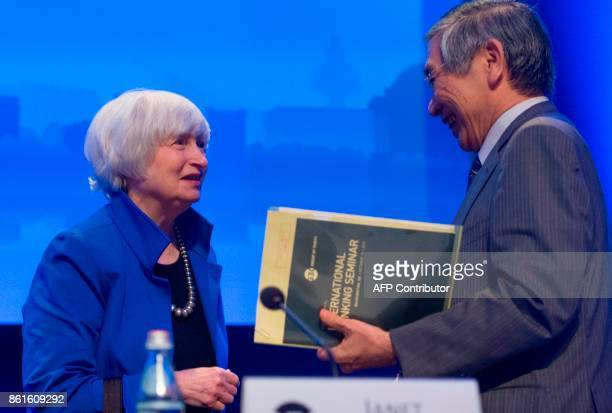 Bank of Japan Governor Haruhiko Kuroda speaks with Federal Reserve Chair Janet Yellen during the 32nd Annual Group of 30 International Banking...