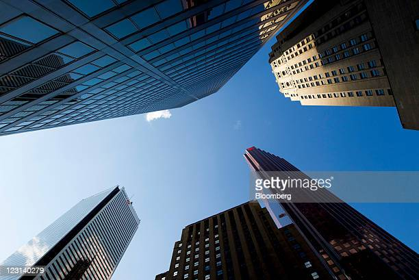 Bank of Montreal Bank of Nova Scotia and Scotiabank Capital Trust offices stand on Bay Street in Toronto Ontario Canada on Monday Aug 29 2011 Bay...