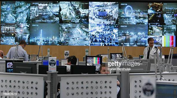 A bank of television monitors displays images captured by a fraction of London's CCTV camera network within the Metropolitan Police's Special...