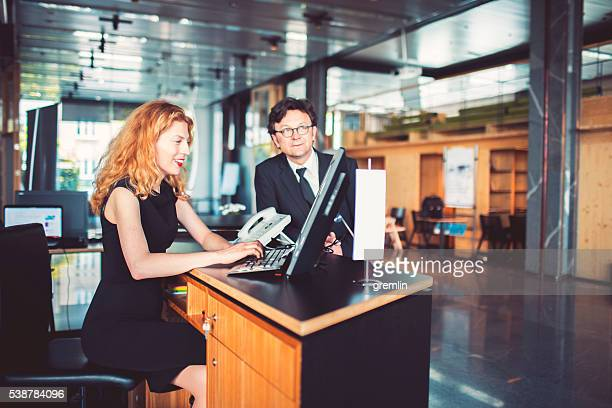 Bank receptionist helping customer, businessman