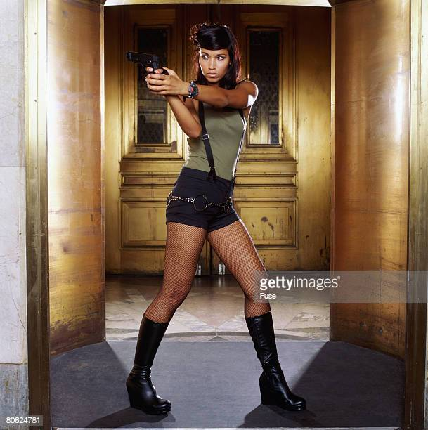 Bank Robber Aiming Pistol in Doorway