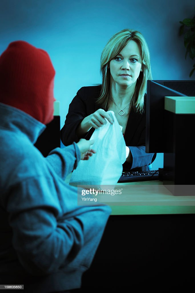 Bank Robber in Action Robbing Retail Banking Teller Counter : Stock Photo