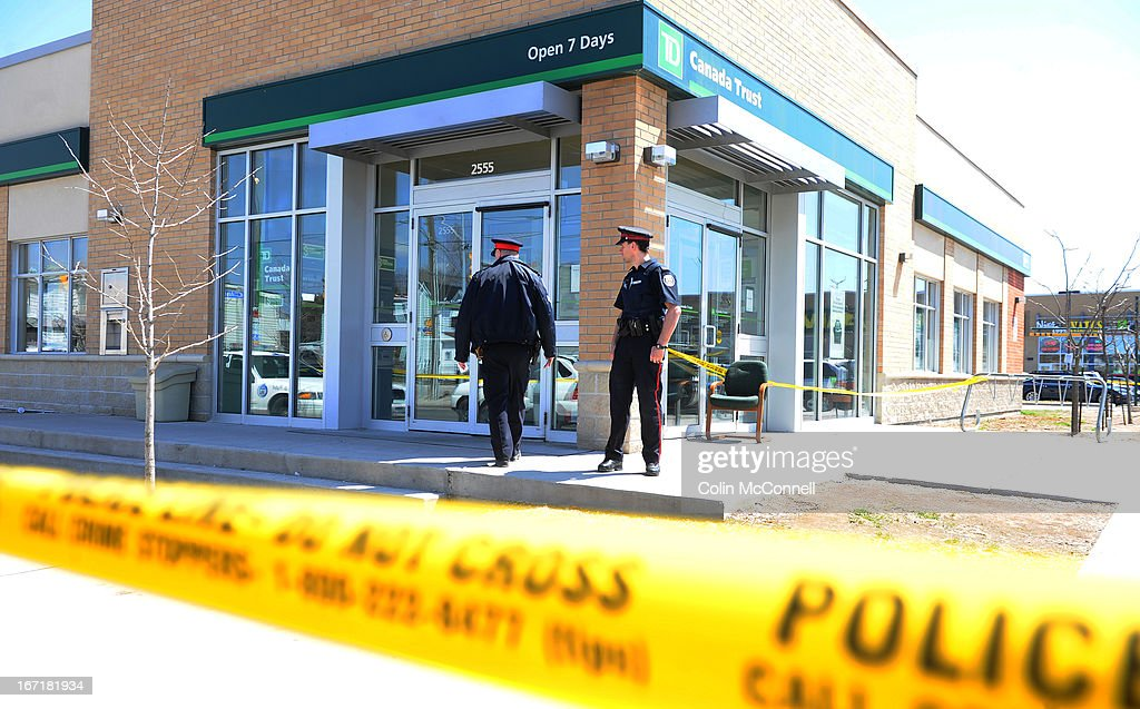 Bank robbery at the TD Canada Trust on St Clair ave West today April 21st 2013...Two people were shot in the robbery and the robbers escaped with an unspecified amount of money in a stolen Honda...Police and forensics around the bank and witnesses being let out of the bank and ushered into taxis by bank employees.