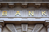 Bank sign above the door of financial building concept for finance and business
