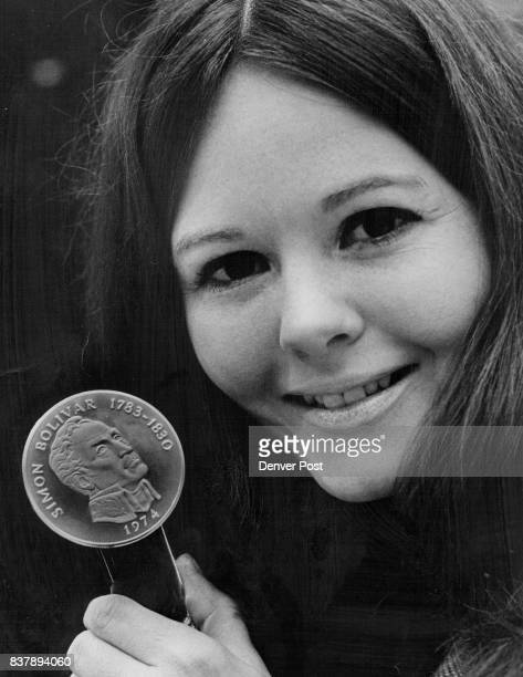 Bank teller Cindy Brown shows a 1974 Panama 20 Balboas that's on splay at the First National Bank of Denver The coin almost 21/2 inches in diameter...