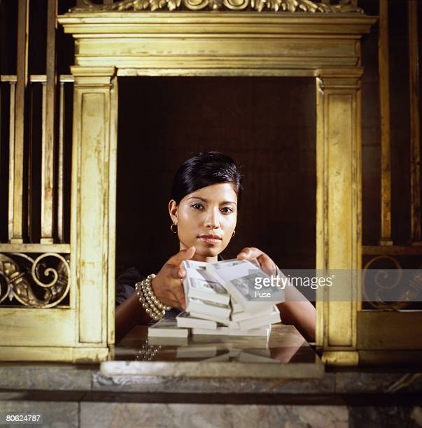 Bank Teller Giving Money at Window