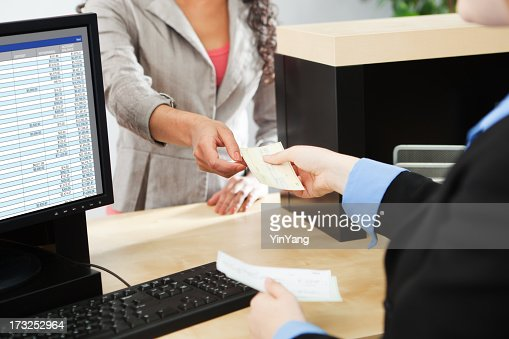 bank teller service with customer deposit transaction over business counter stock photo getty. Black Bedroom Furniture Sets. Home Design Ideas