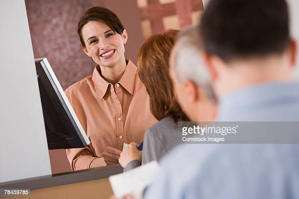 Bank teller waiting on customer