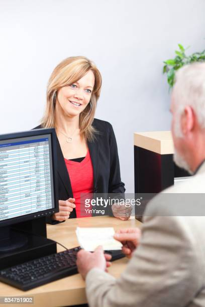 Bank Teller Working with Customer at Retail Bank