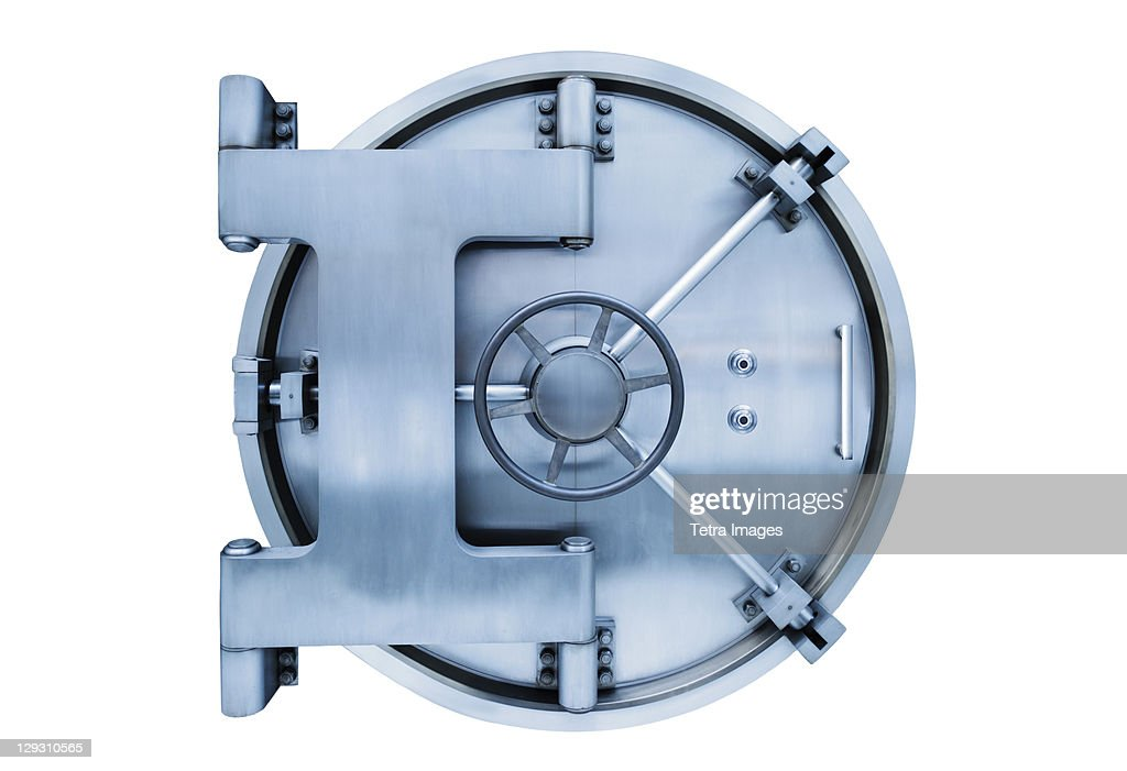 Bank vault door on white background