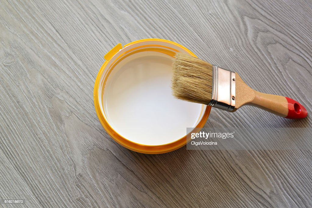 Bank with white paint and brush on  floor : Bildbanksbilder