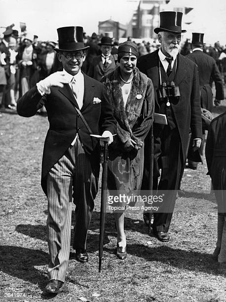Banker Anthony Rothschild his wife and Lord d'Abernon walk to the paddock at the Oaks at Epsom on Ladies' Day