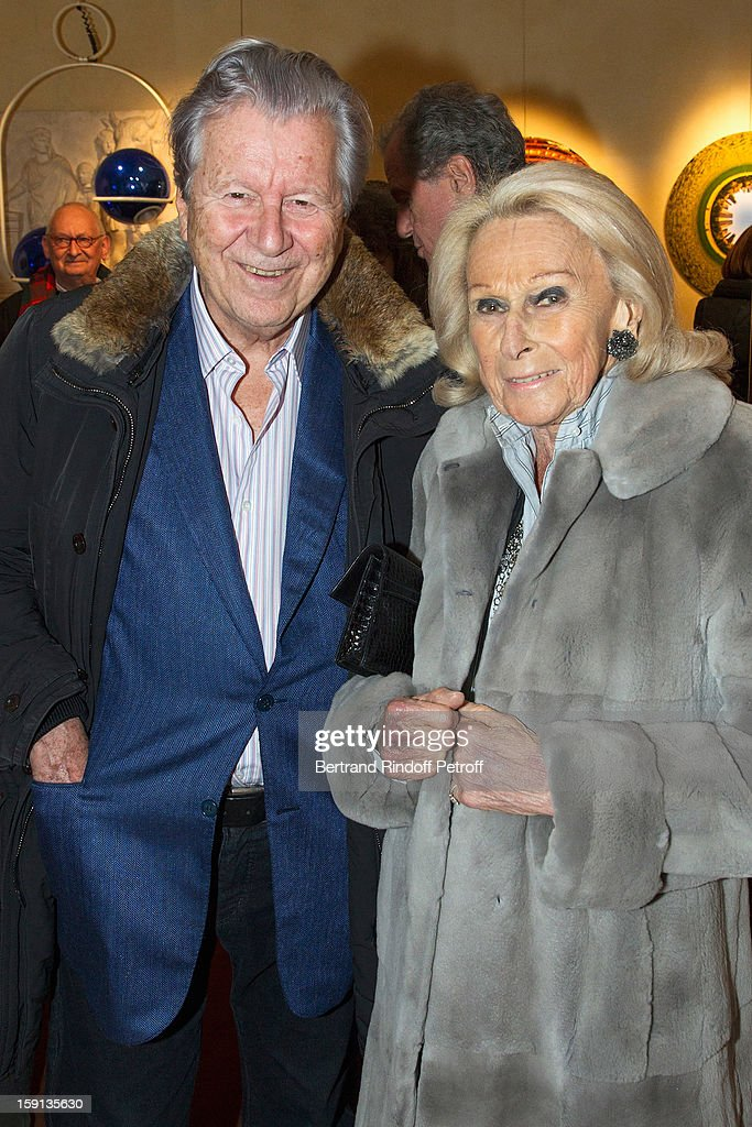 Banker Bruno Roger (L) and Micheline Mauss attend the 'Sorcieres' (Witches) exhibition preview at Galerie Pierre Passebon on January 8, 2013 in Paris, France.