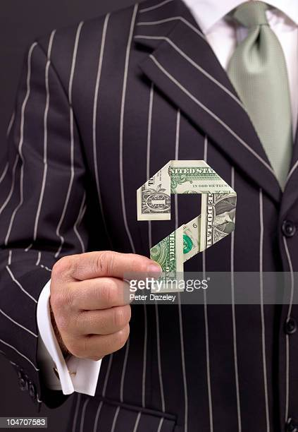 Banker holding 1 dollar note question mark