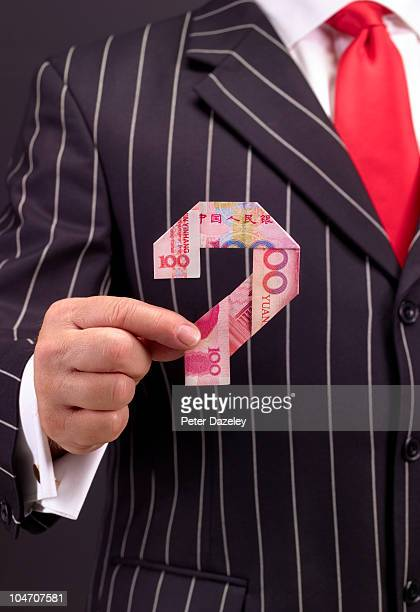 Banker holding 100 chinese yuan question mark