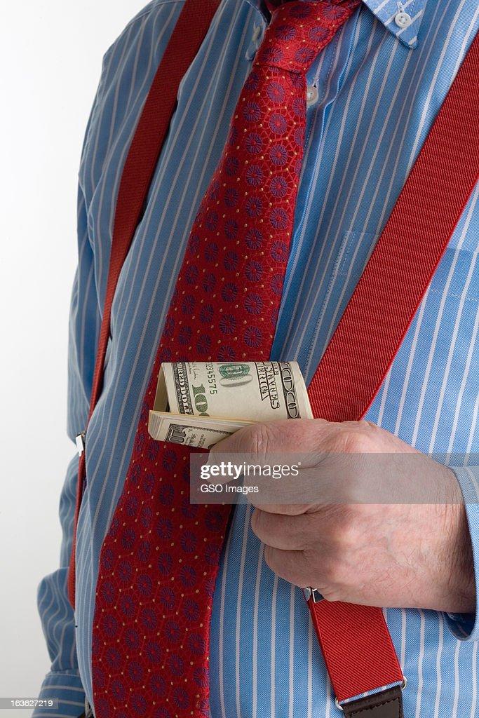Banker holding dollar banknotes : Stock Photo