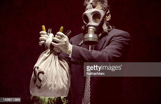 Banker holding toxic assets : Stock Photo